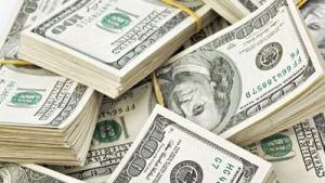 Many  bundle of US 100 dollars bank notes